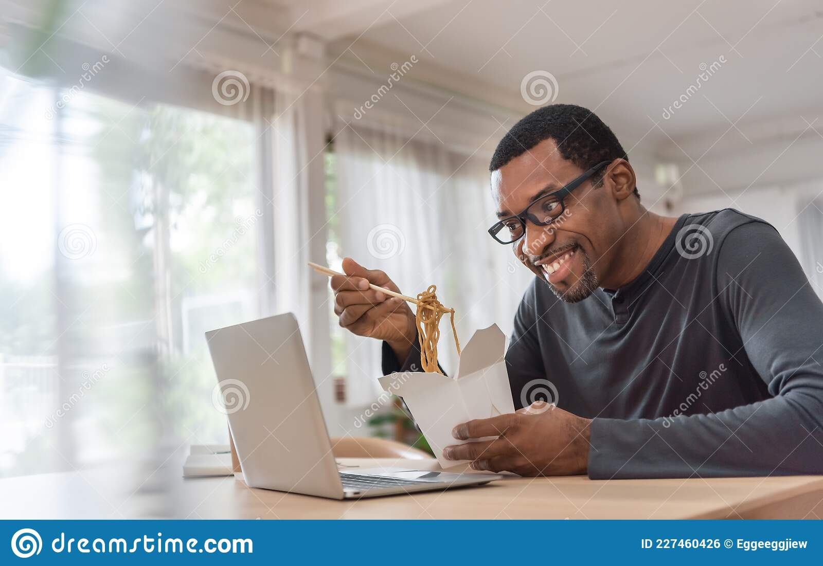 African American Man Eating Noodle With His Friends While