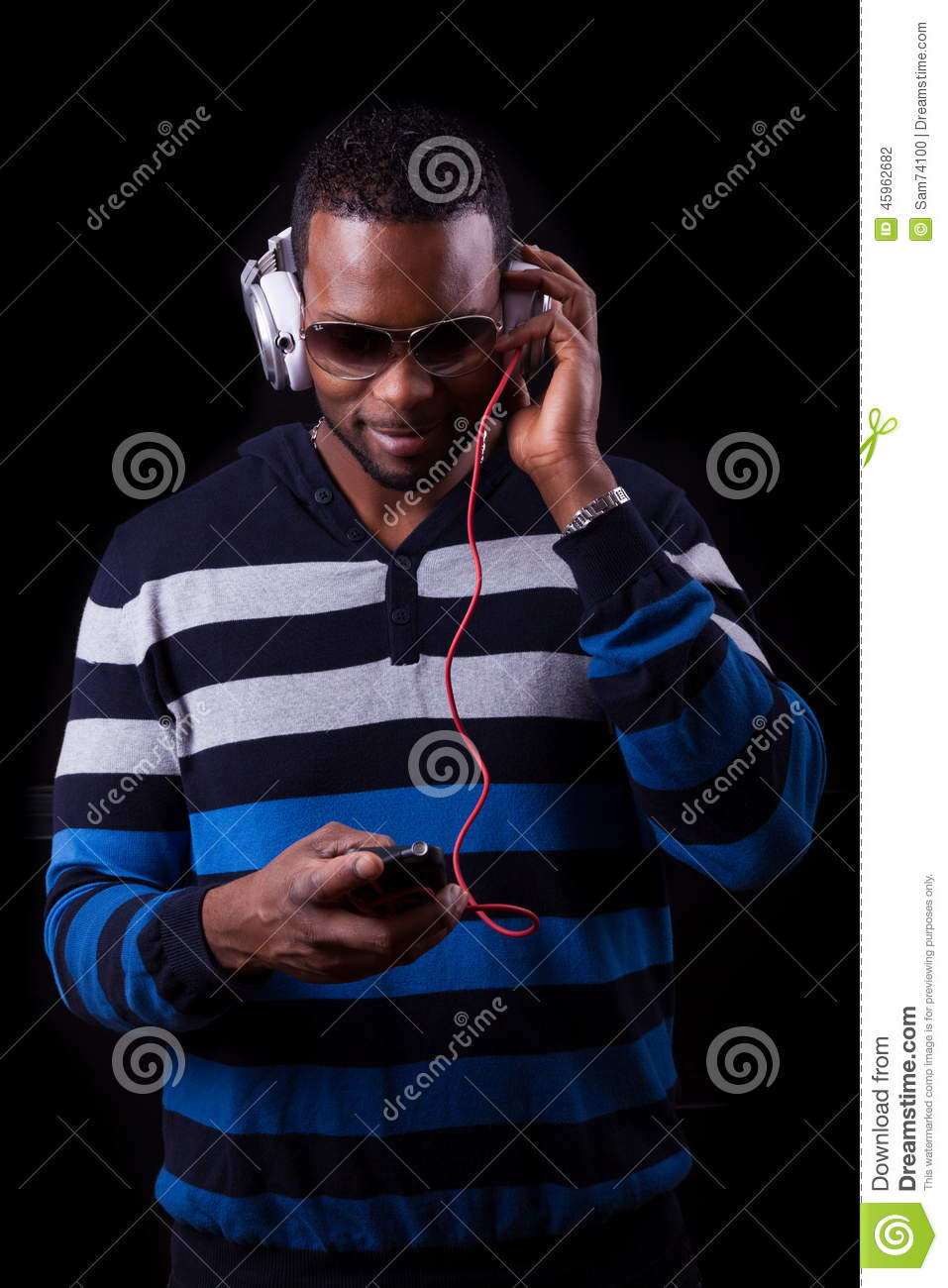African American Man Listening To Music Isolated On Black ...