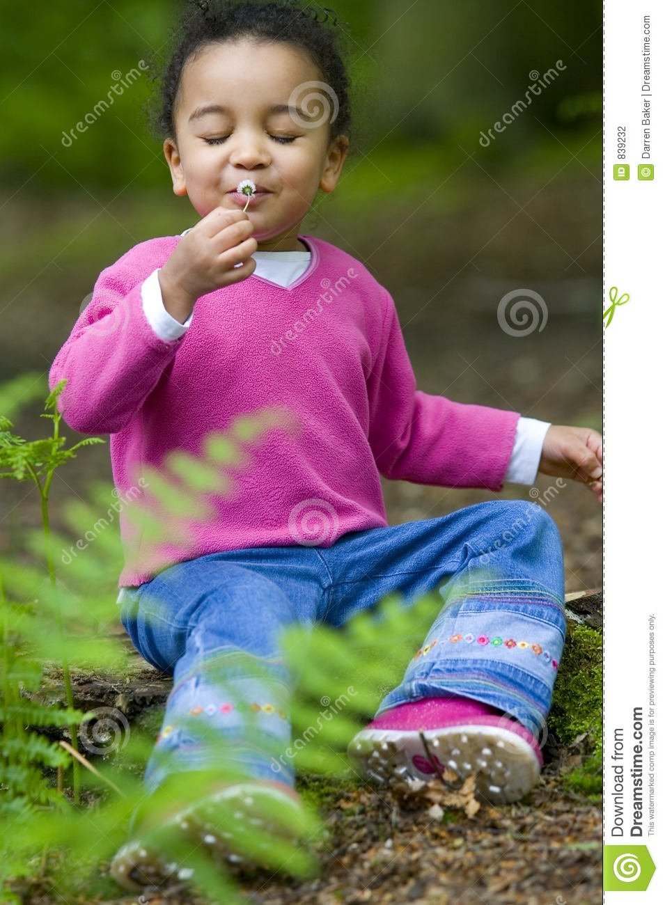 African American Mixed Race Girl Smelling Flower