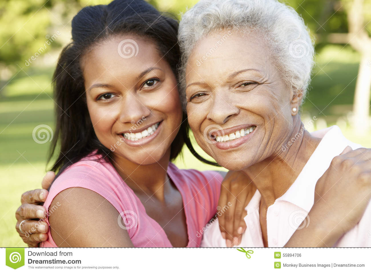 African American Mother And Adult Daughter Relaxing In ...