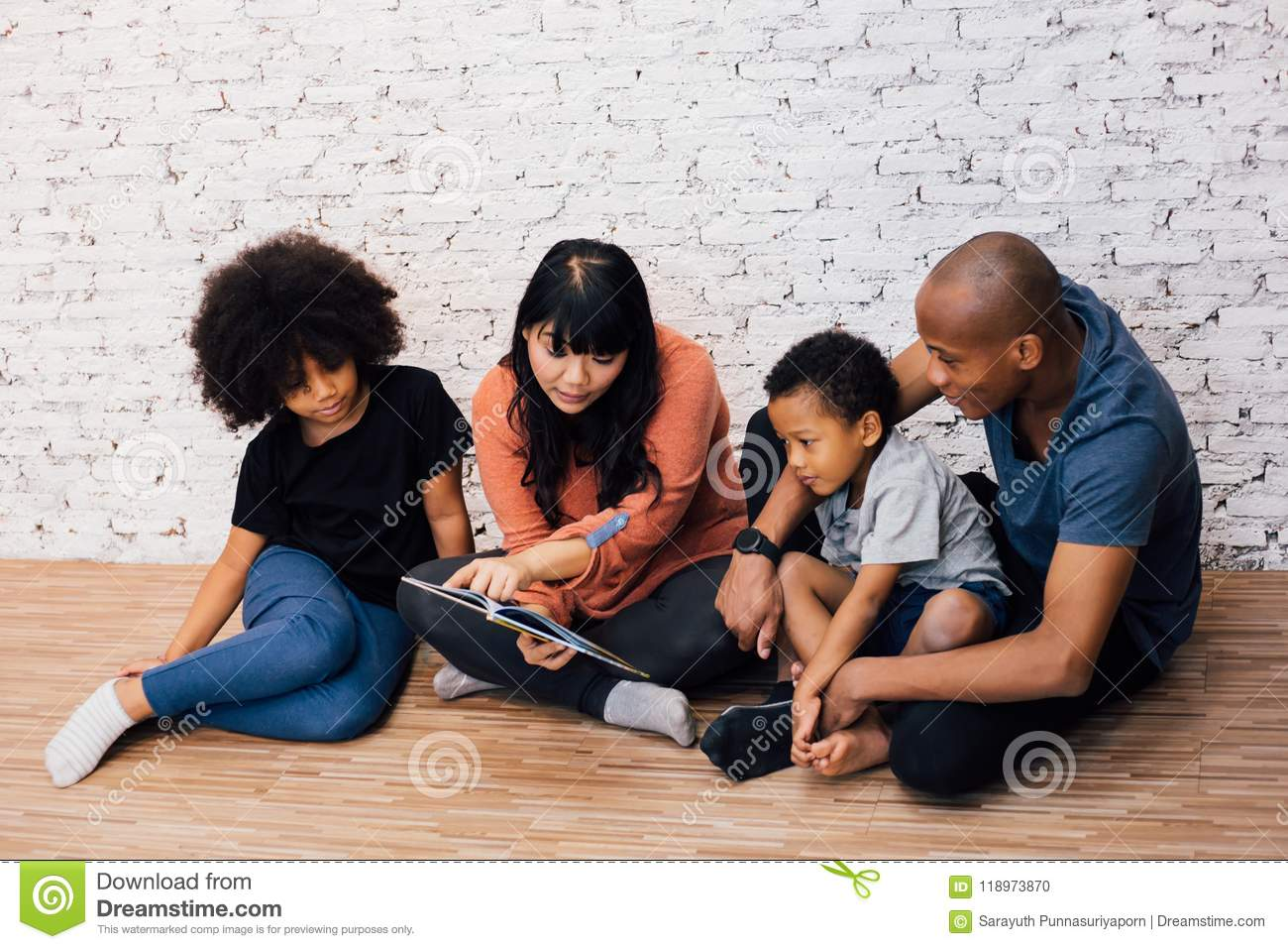 African American parents reading a fairy tale fable story for kiAfrican American parents reading a fairy tale fable story for kids