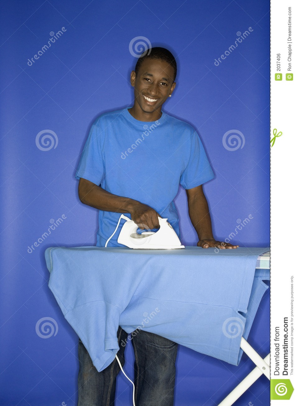 africanamerican teen boy ironing royalty free stock