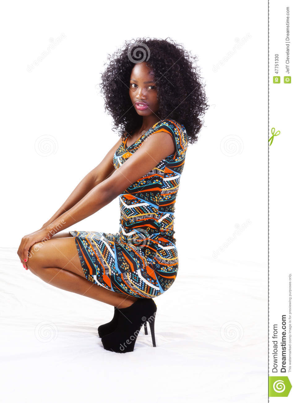 African American Teen Girl Squatting In Dress Stock Photo - Image 47751330-5663