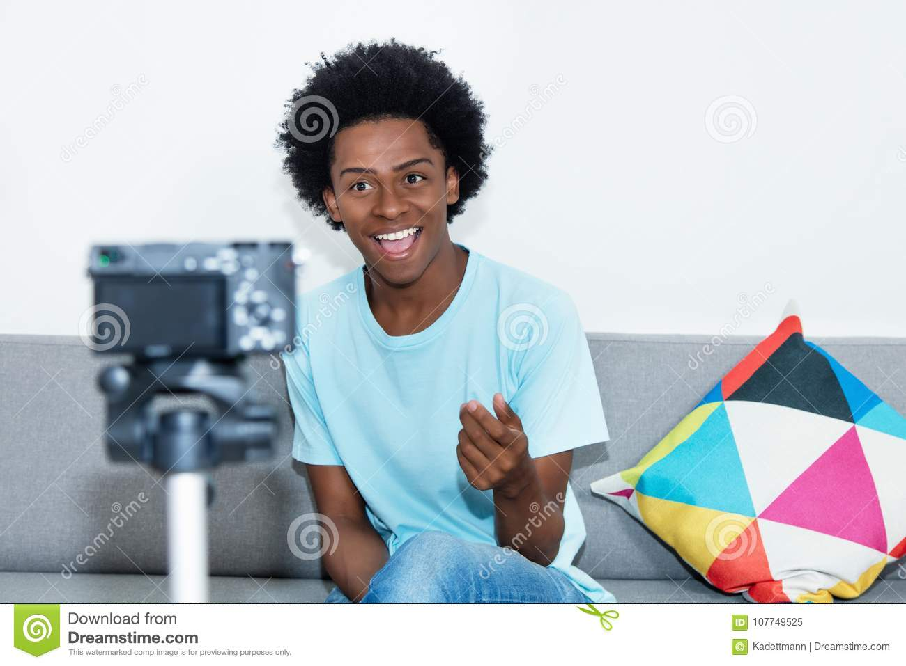 African american vlogger recording video blog