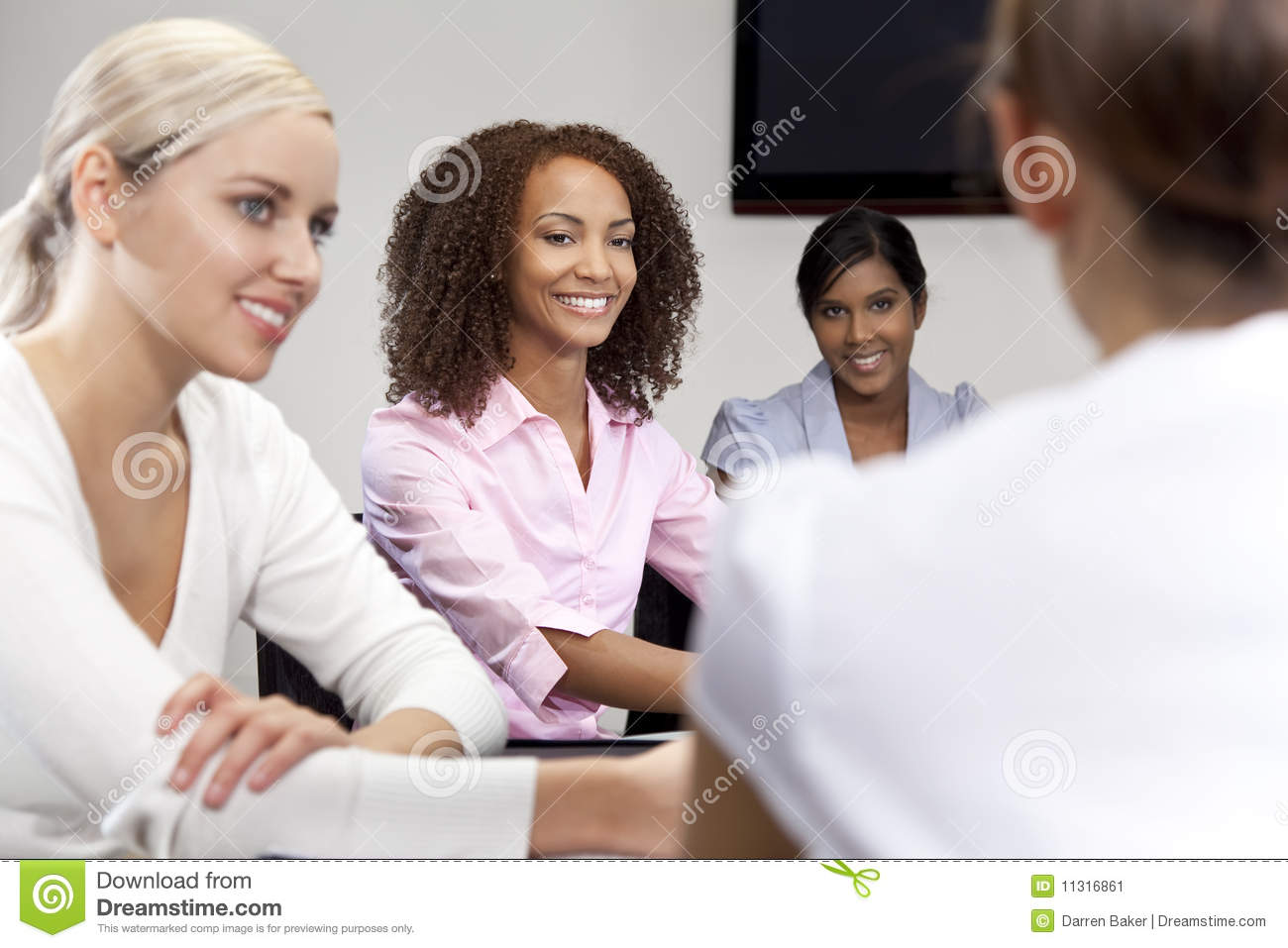 African American Woman At Business Meeting