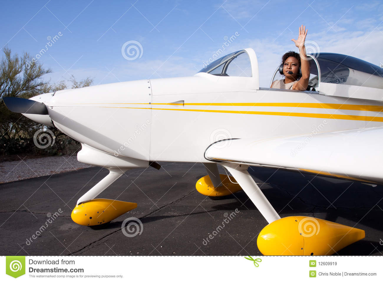 African American Woman Flying A Private Plane Stock Image ...