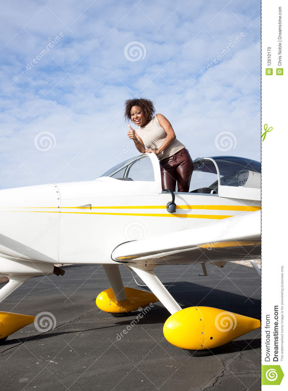 African American Woman Flying A Private Plane Stock Photo ...