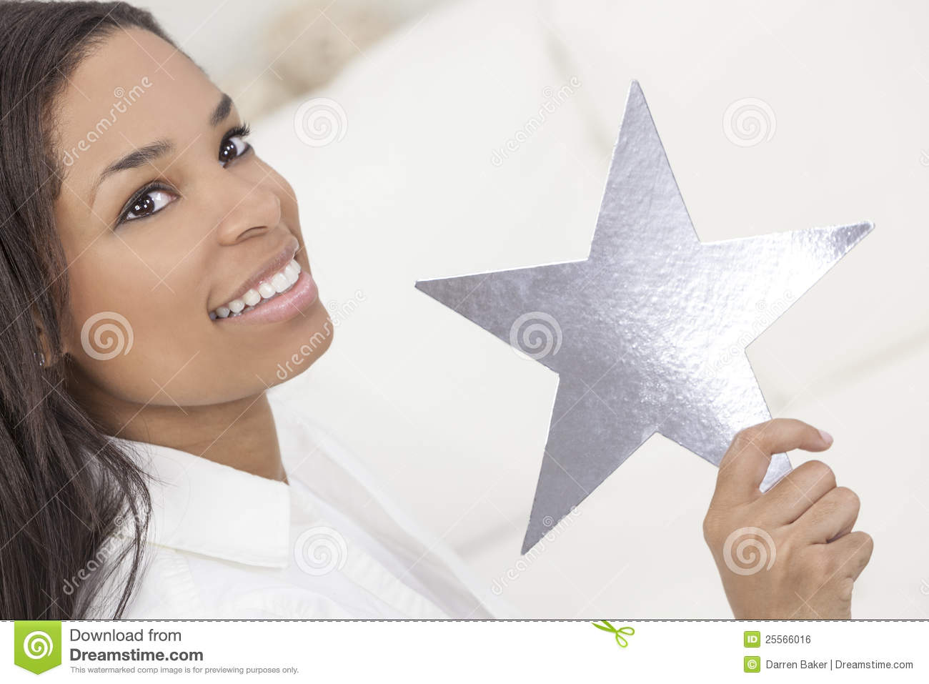 African American woman smiling, relaxing and holding a silver star