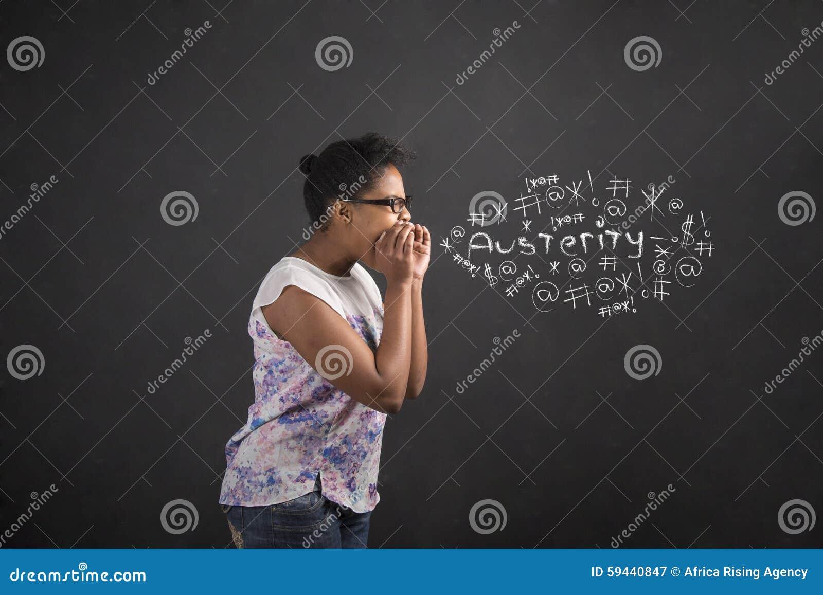 African American woman shouting, screaming or swearing austerity on blackboard background