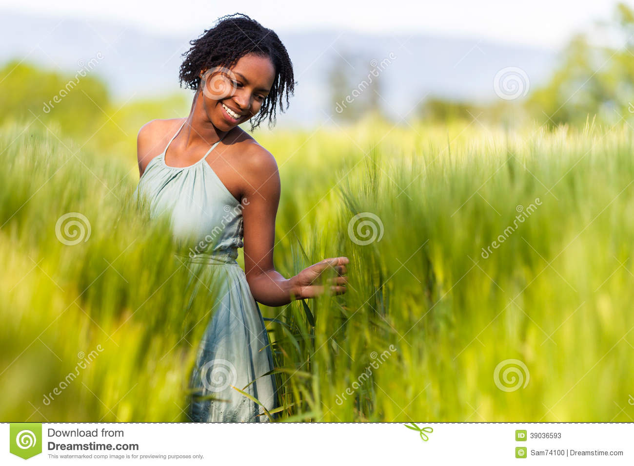African American Woman In A Wheat Field Stock Image ...