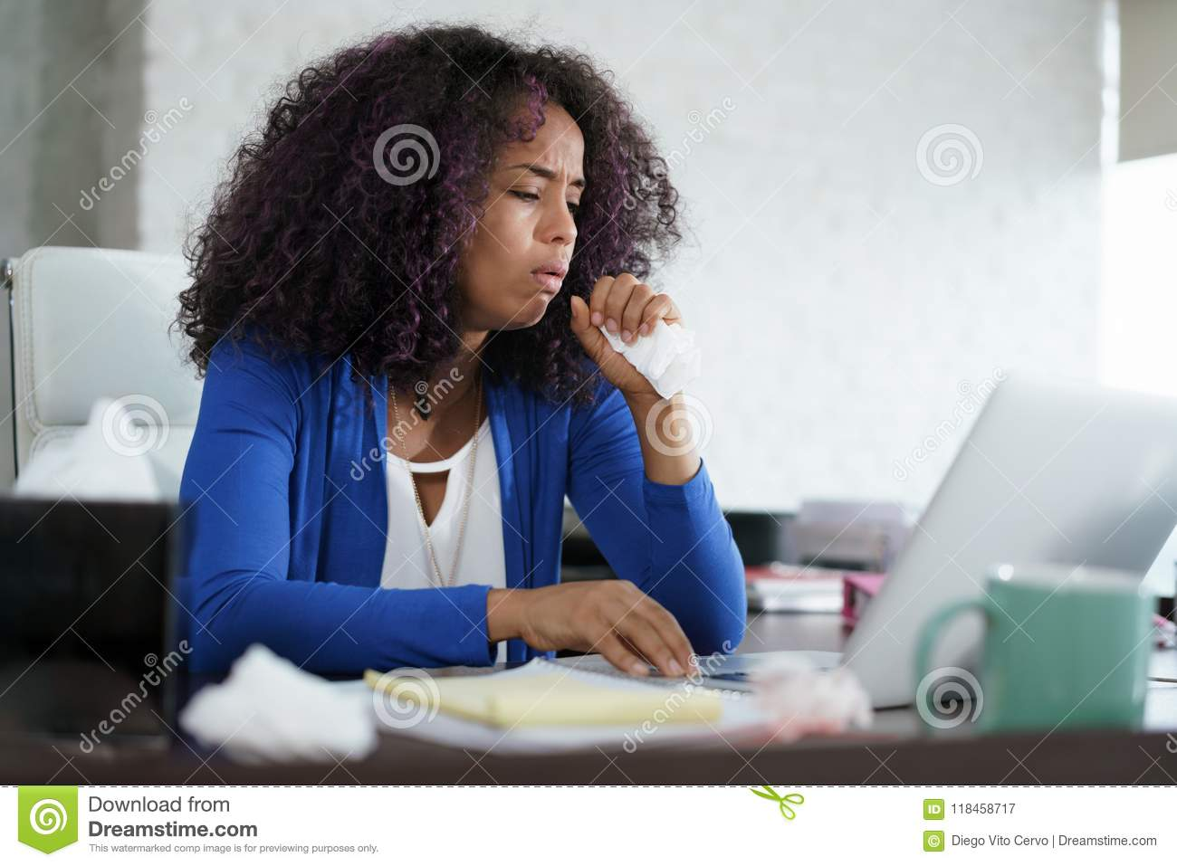 African American Woman Working At Home Coughing And Sneezing