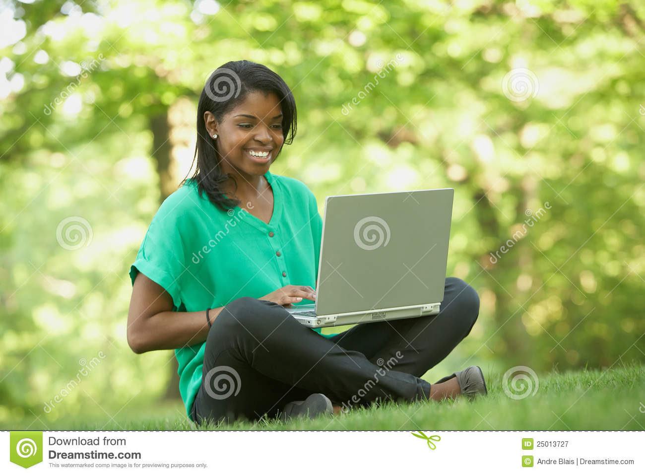 African American young woman using laptop computer