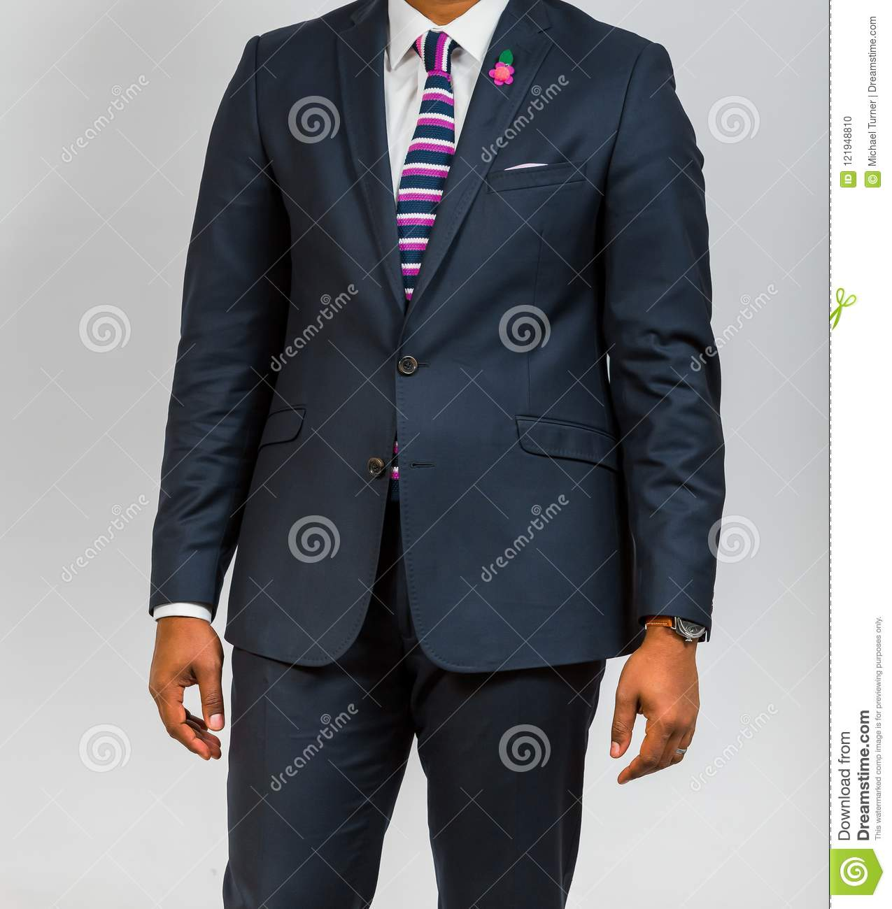 Close up cropped african black hands and arms of businessman in a suit with hands at side