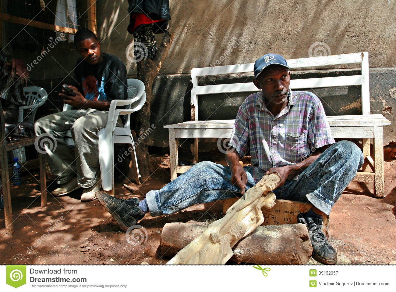 African Black Wood Carver Working Art Workshop Editorial
