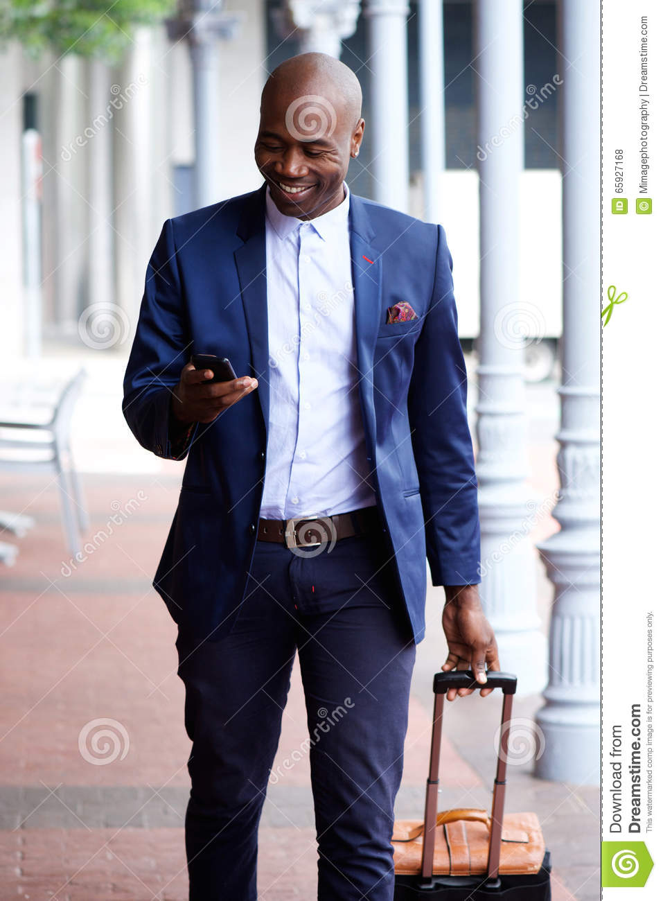 Handsome Black Businessman Traveling With Bag And Cell ...
