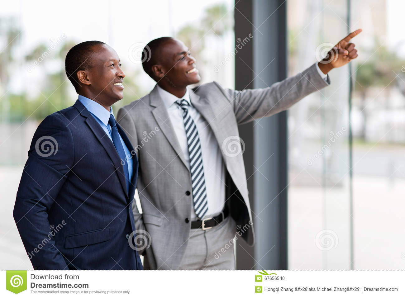 African business men pointing