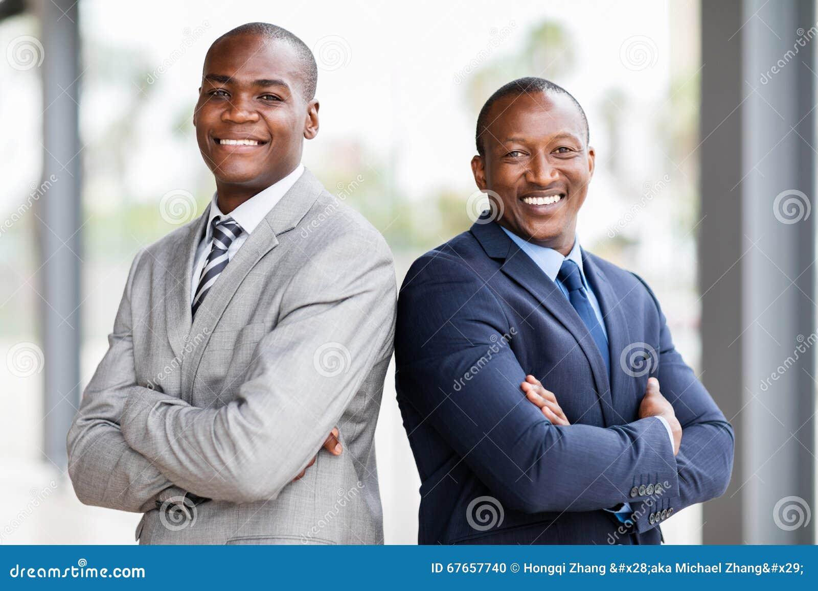 african businessmen arms crossed