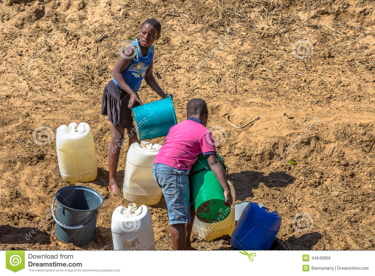 local children collecting water in the community   Flickr