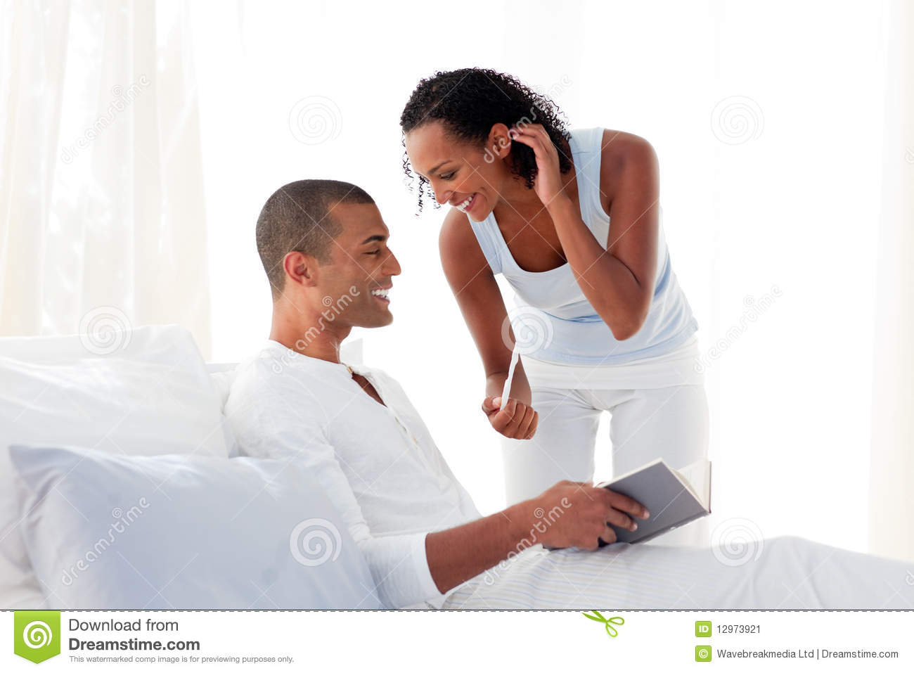african couple finding results of a pregnancy test stock image image 12973921. Black Bedroom Furniture Sets. Home Design Ideas