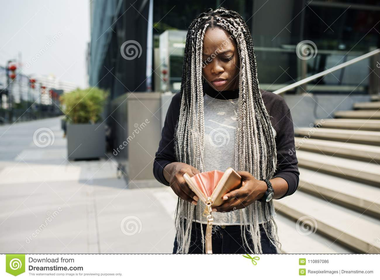 Download African Descent Checking Her Wallet Stock Photo - Image of lifestyle, bill: 110897086