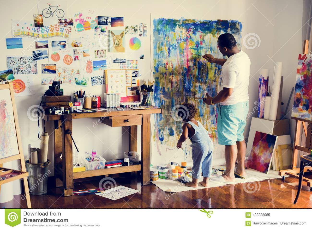 African father and son painting work of art