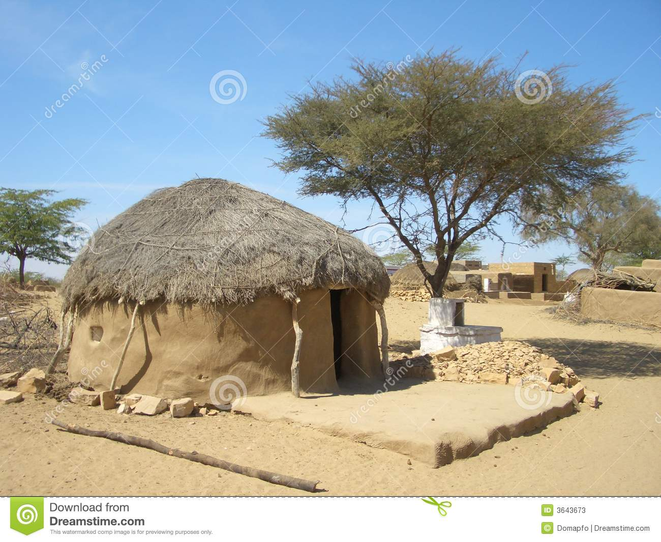 Cob cottage with thatched straw roof in African desert village, Africa ...
