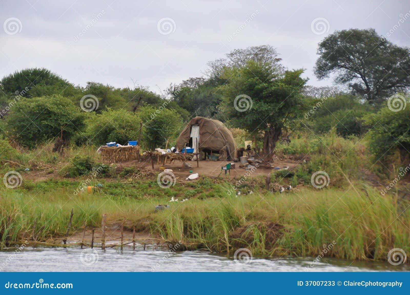 African Hut Next To River Stock Photos Image 37007233
