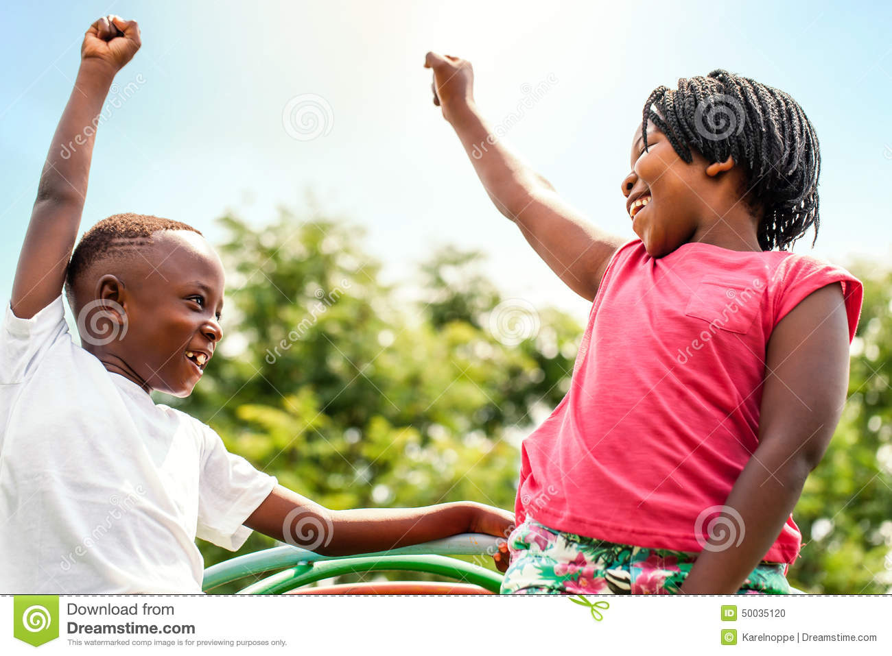 African kids looking at each other raising hands.