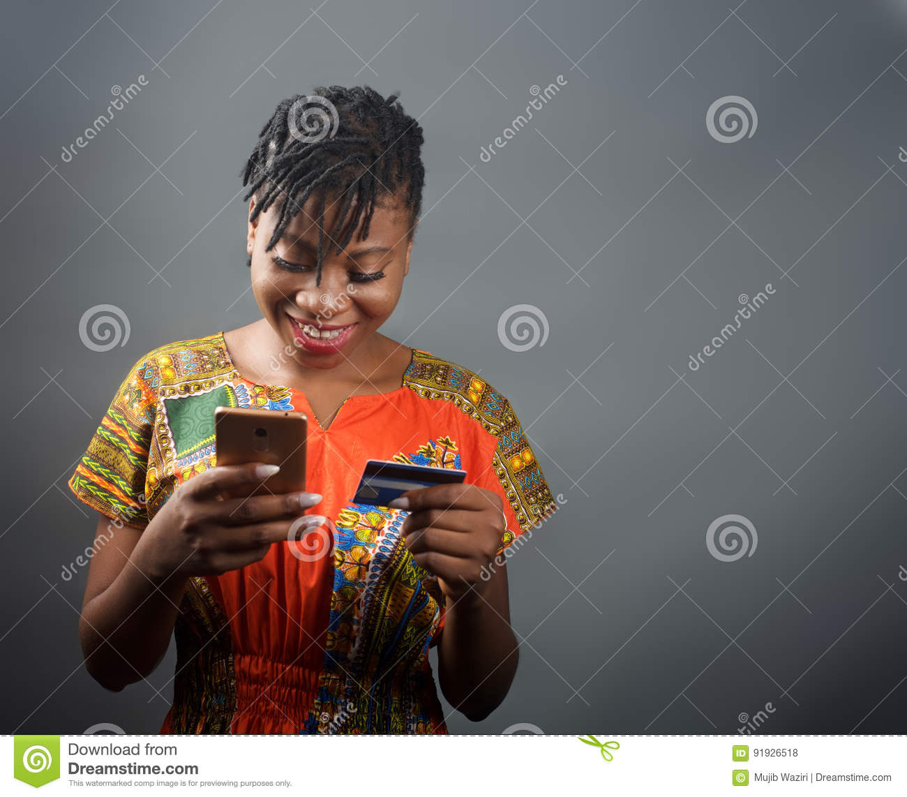 An african lady making an online payment with a debit card