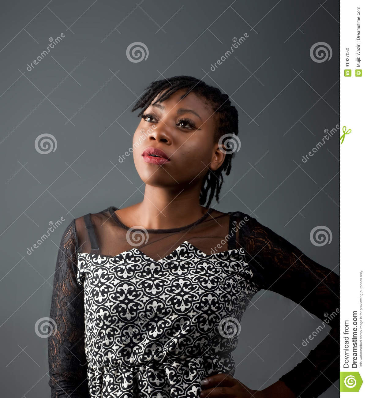 African lady posed away from the camera