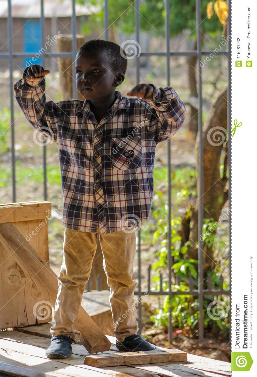 African little boy standing, small kids playing