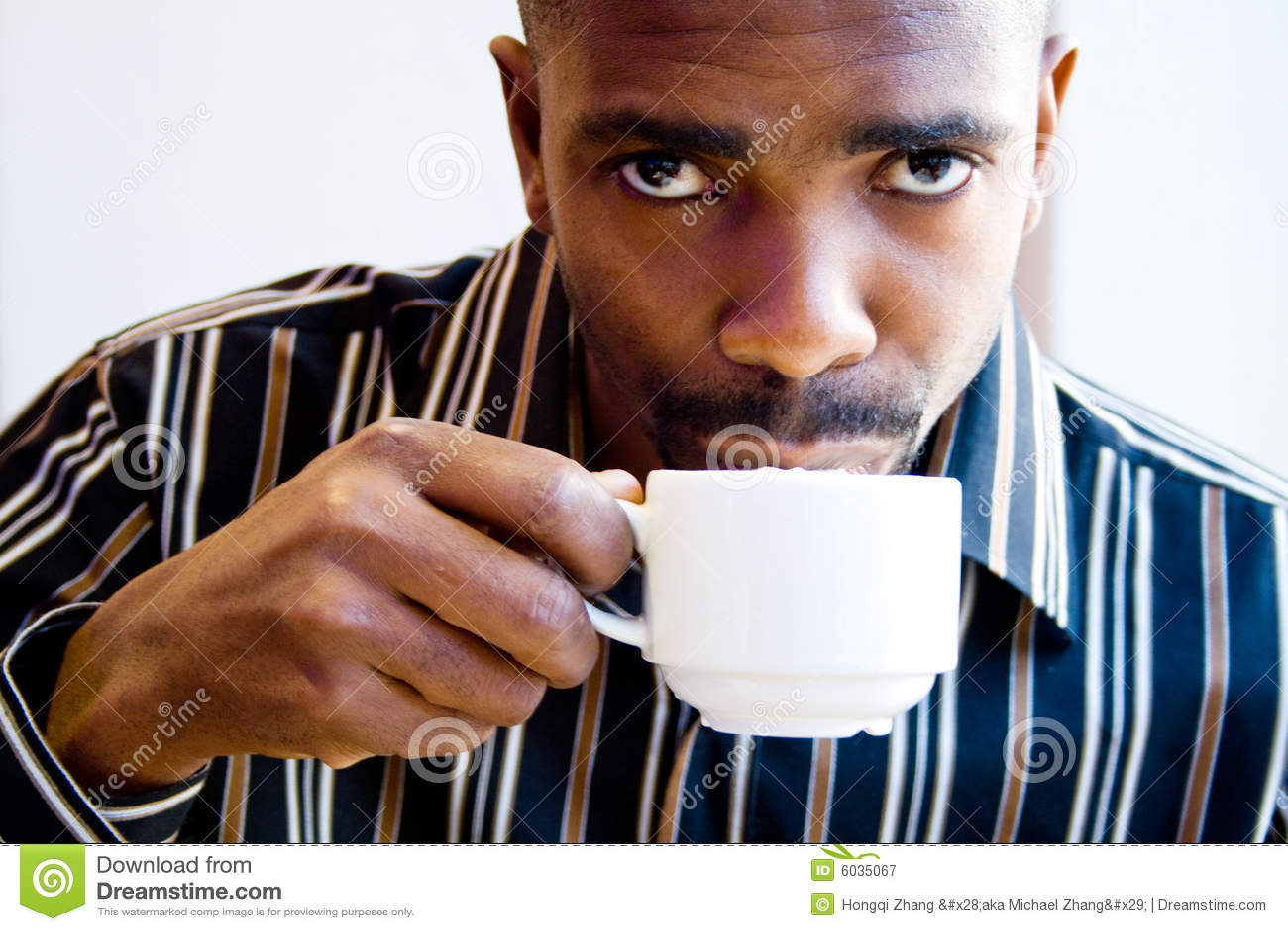 African Man Drinking C...