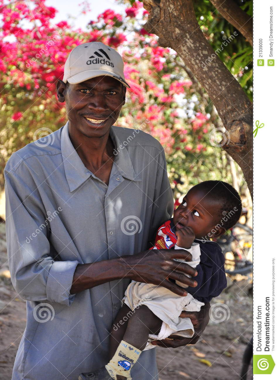 African man holding child editorial image. Image of ...