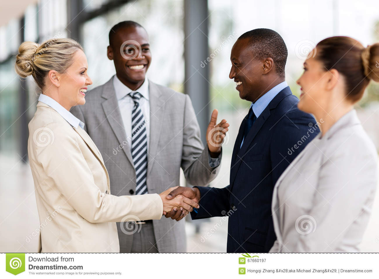 African man introducing businesswoman