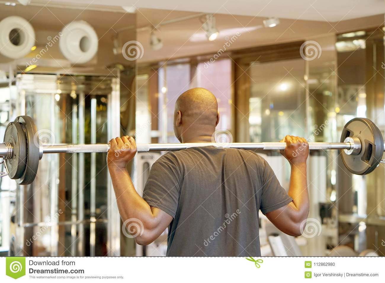 African man lifting a barbell back view stock photo image of