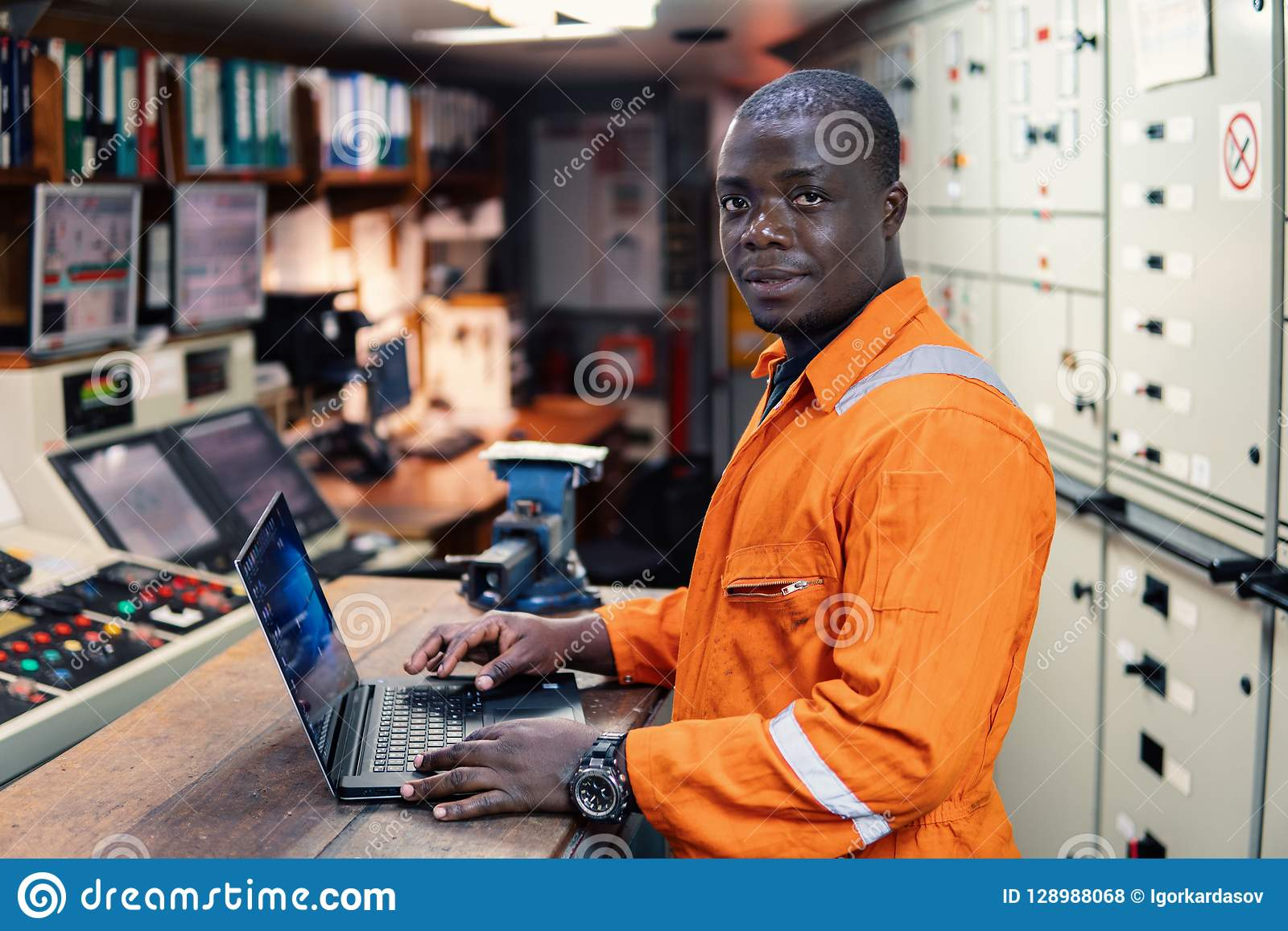 Marine engineer officer working in engine room