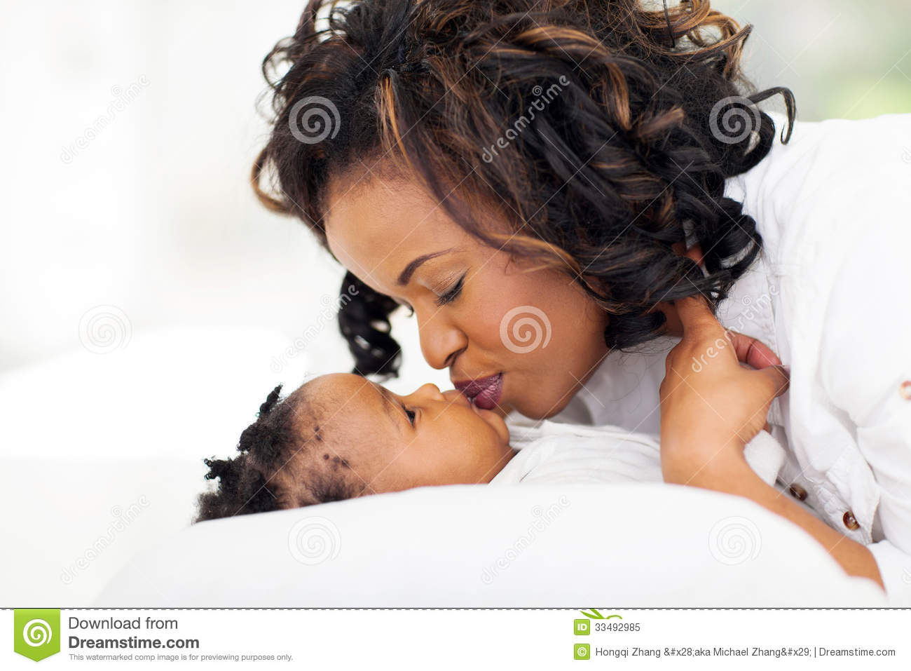 Download African Mother Kissing Baby Stock Image - Image of bedroom, bedding: 33492985