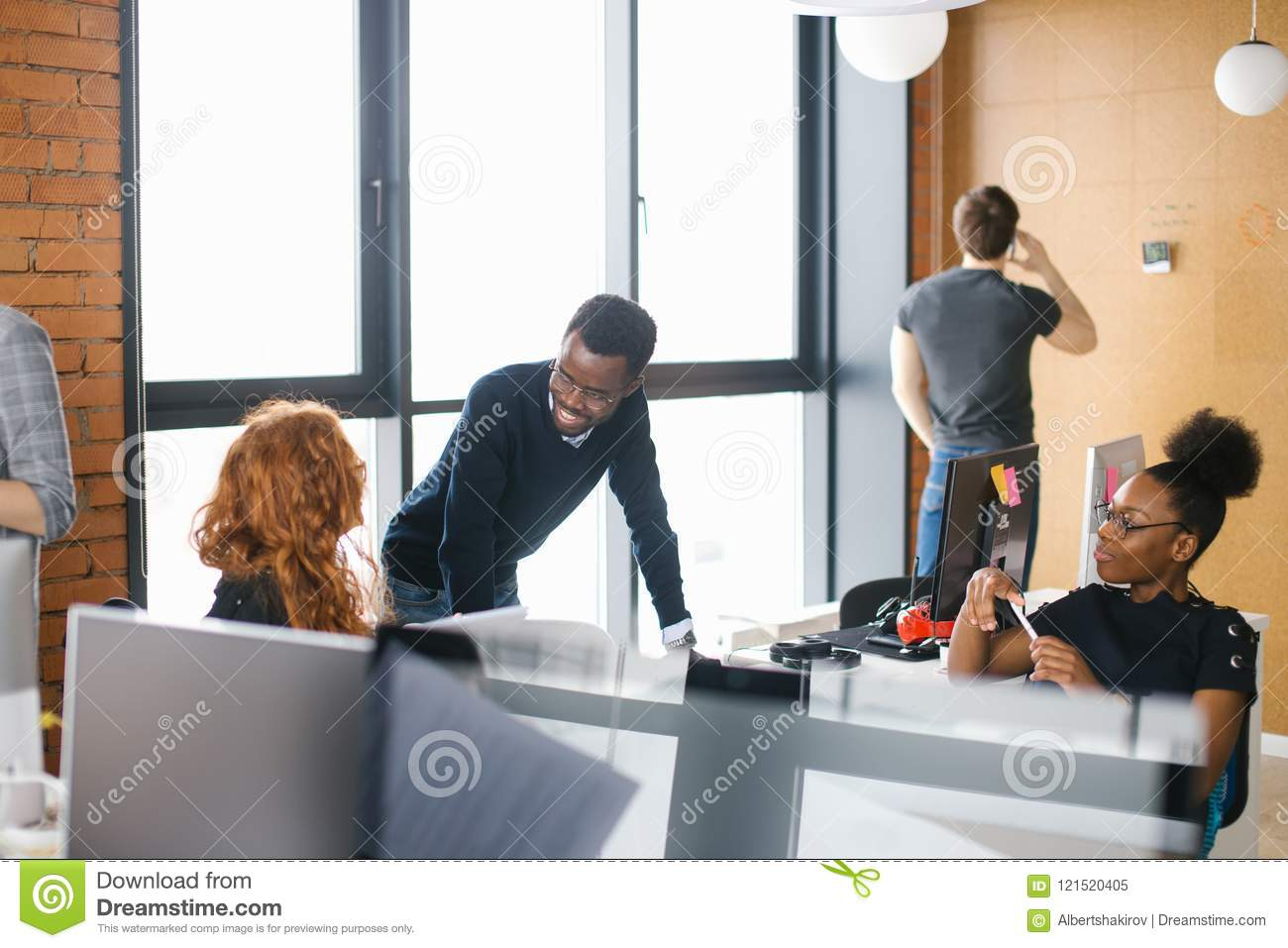 African Office Assistants Are Greeting Caucasian Woman With Long Red