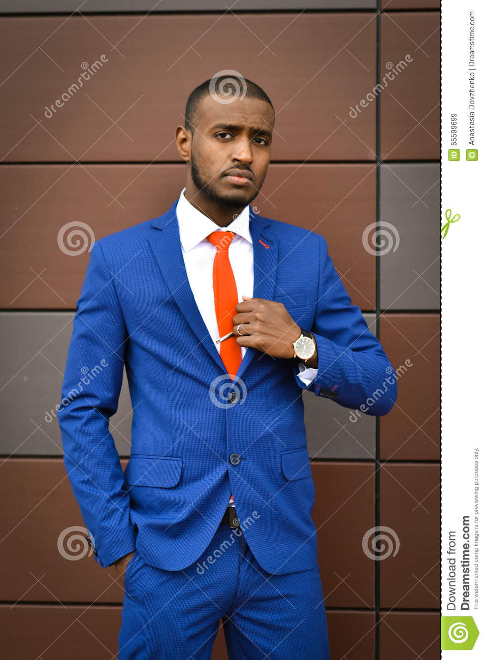 African student corrects a tie.Important serious businessman,boss,banker, an office employee, lawyer.