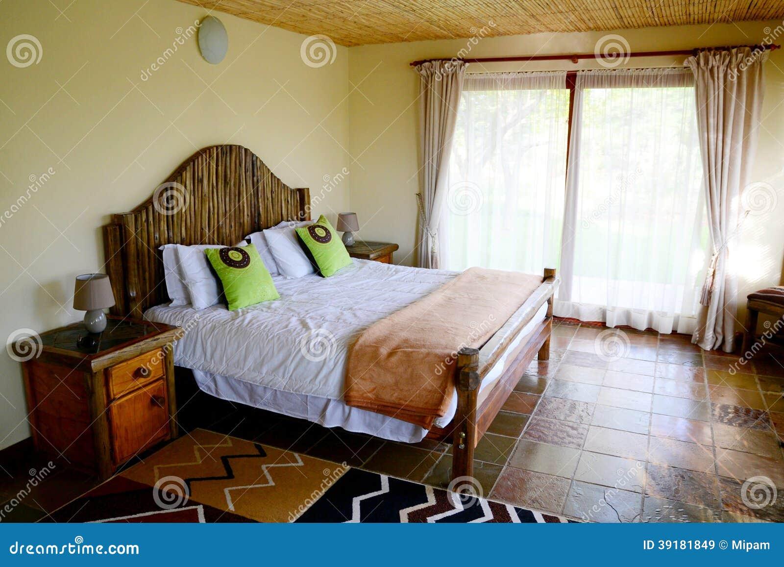 african style bedroom stock image image of motel inside 39181849. Black Bedroom Furniture Sets. Home Design Ideas