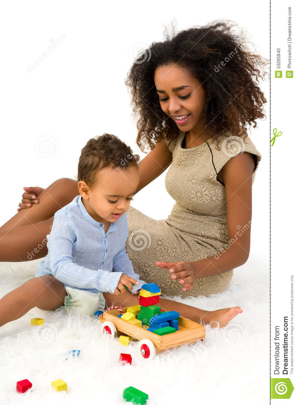African toddler playing with blocks