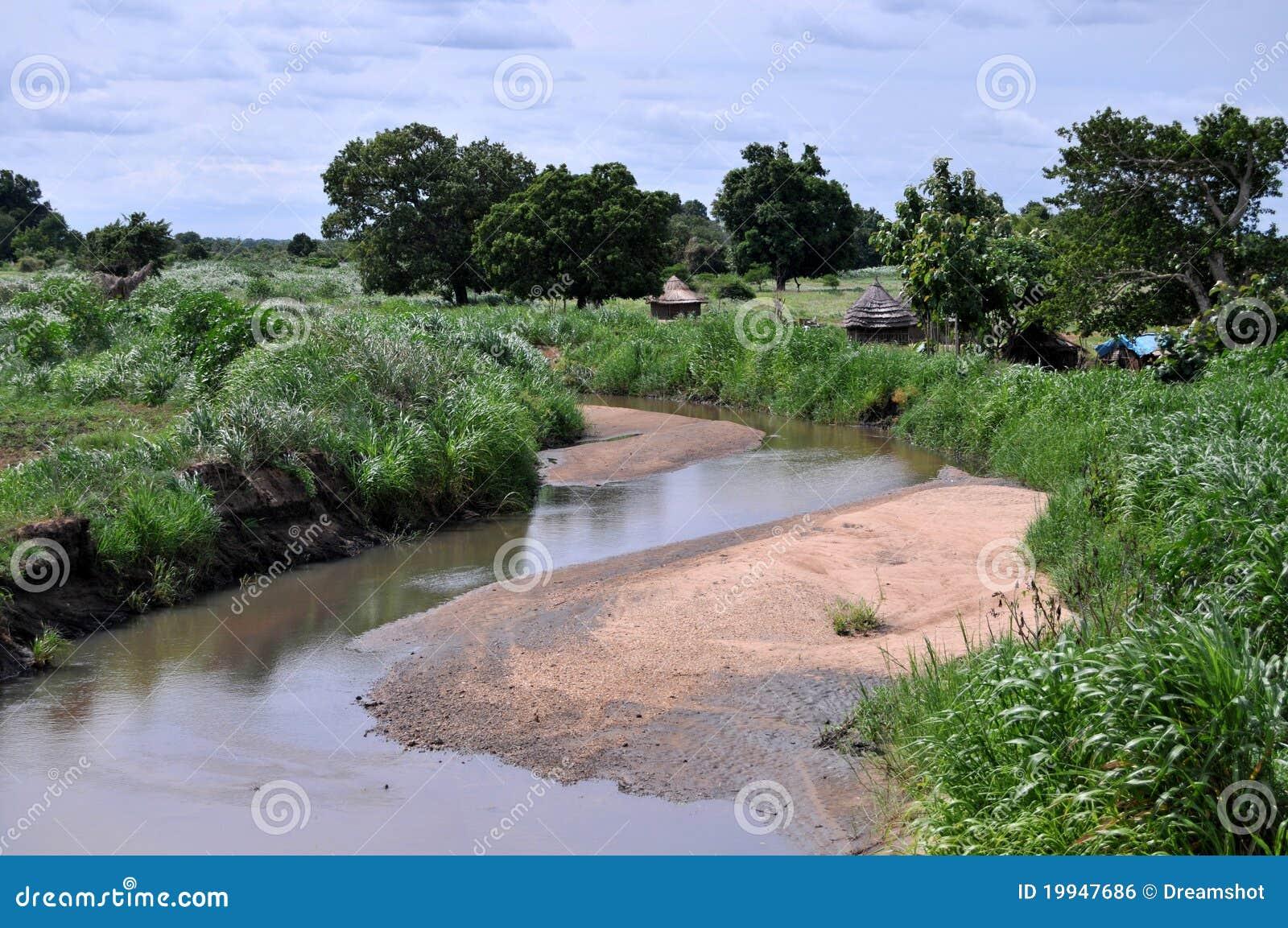 African village on riverside