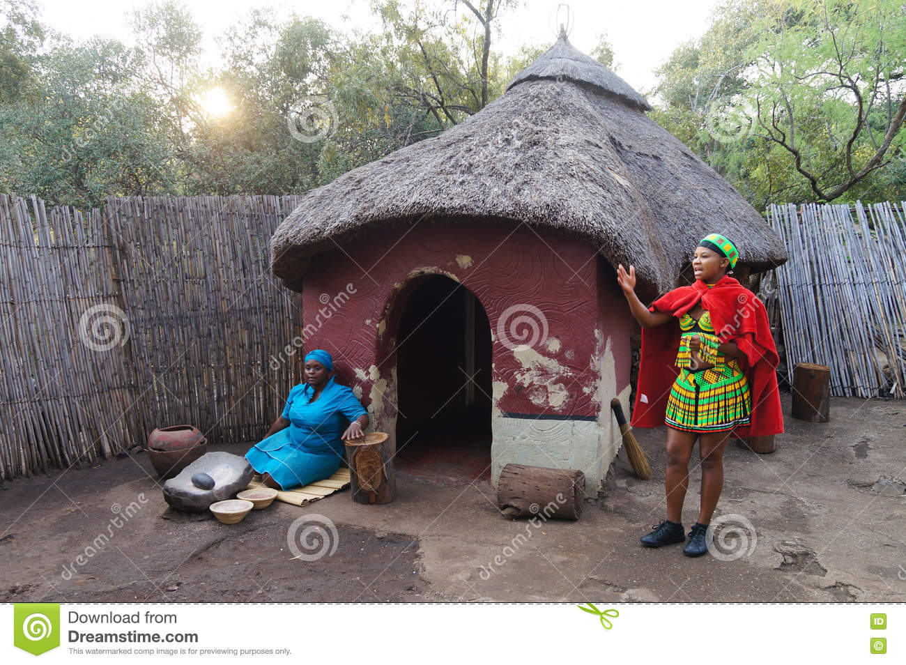African woman cooking maize meal at tribal house at lesedi for Tribal house