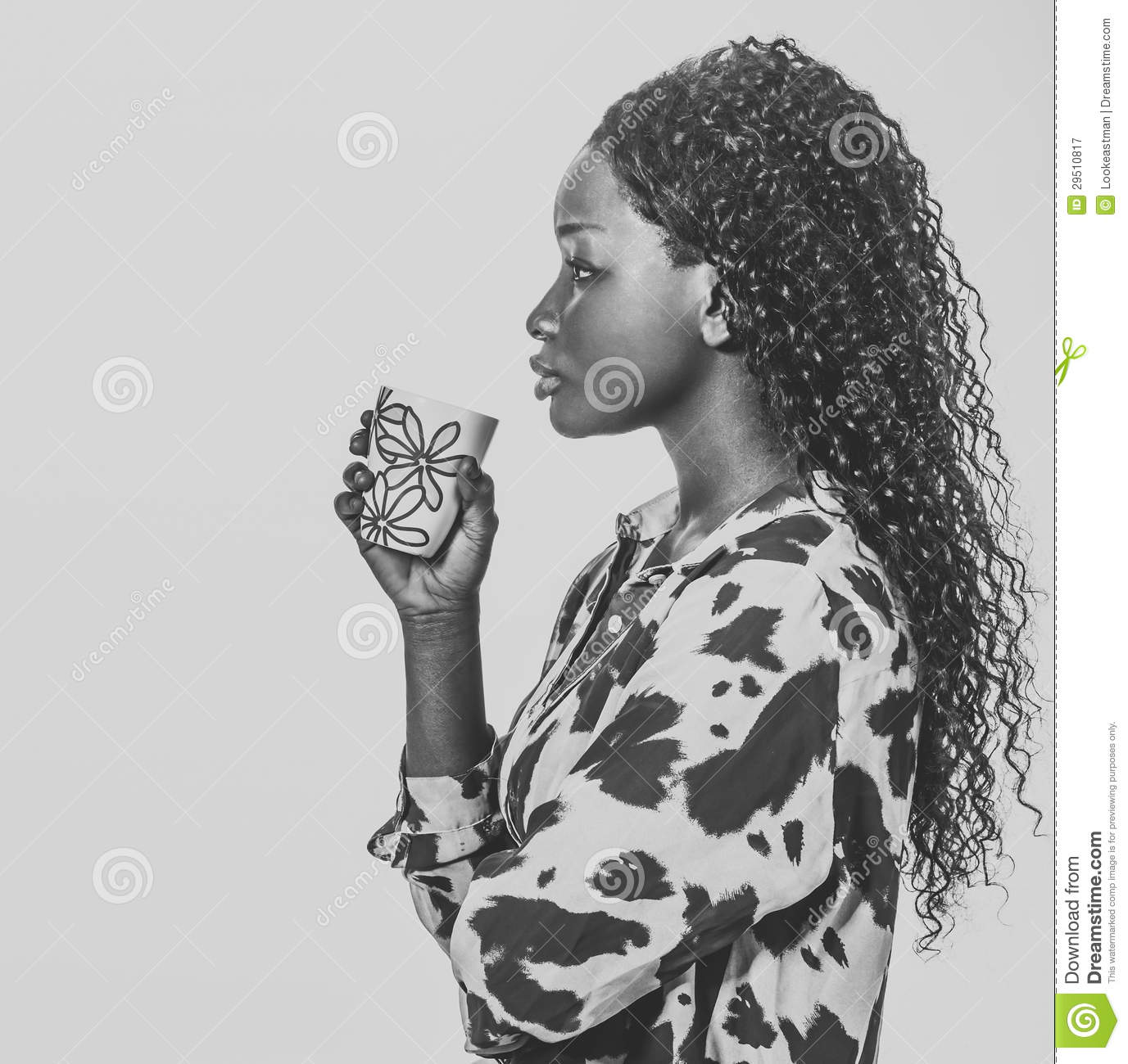 African woman drinking coffee silhouette