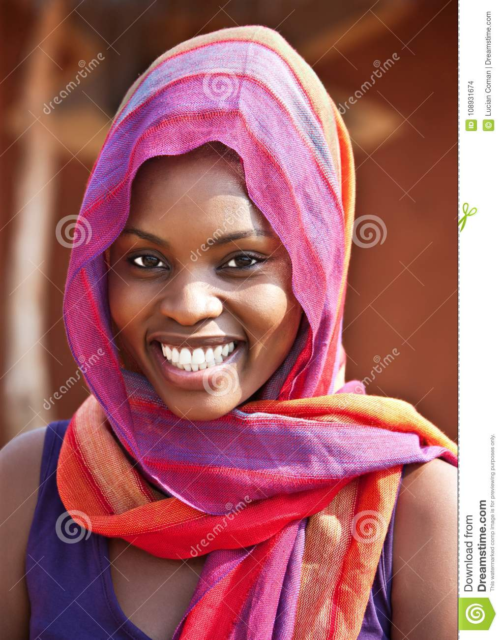 Download African Woman In Front Of The House Stock Photo - Image of life, hijab: 108931674
