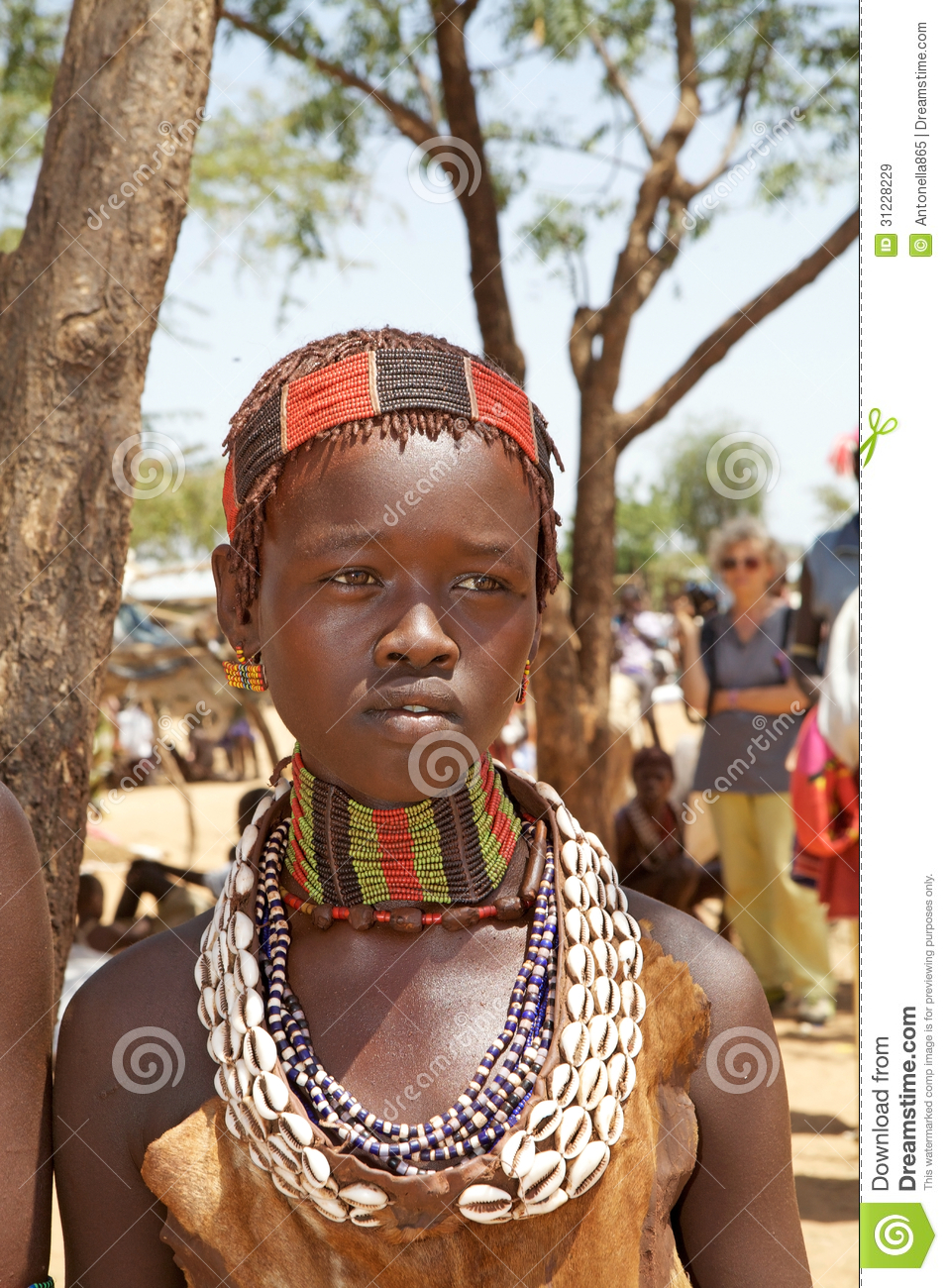 African woman of the Hamer ethnic group with tribal clothes and hair