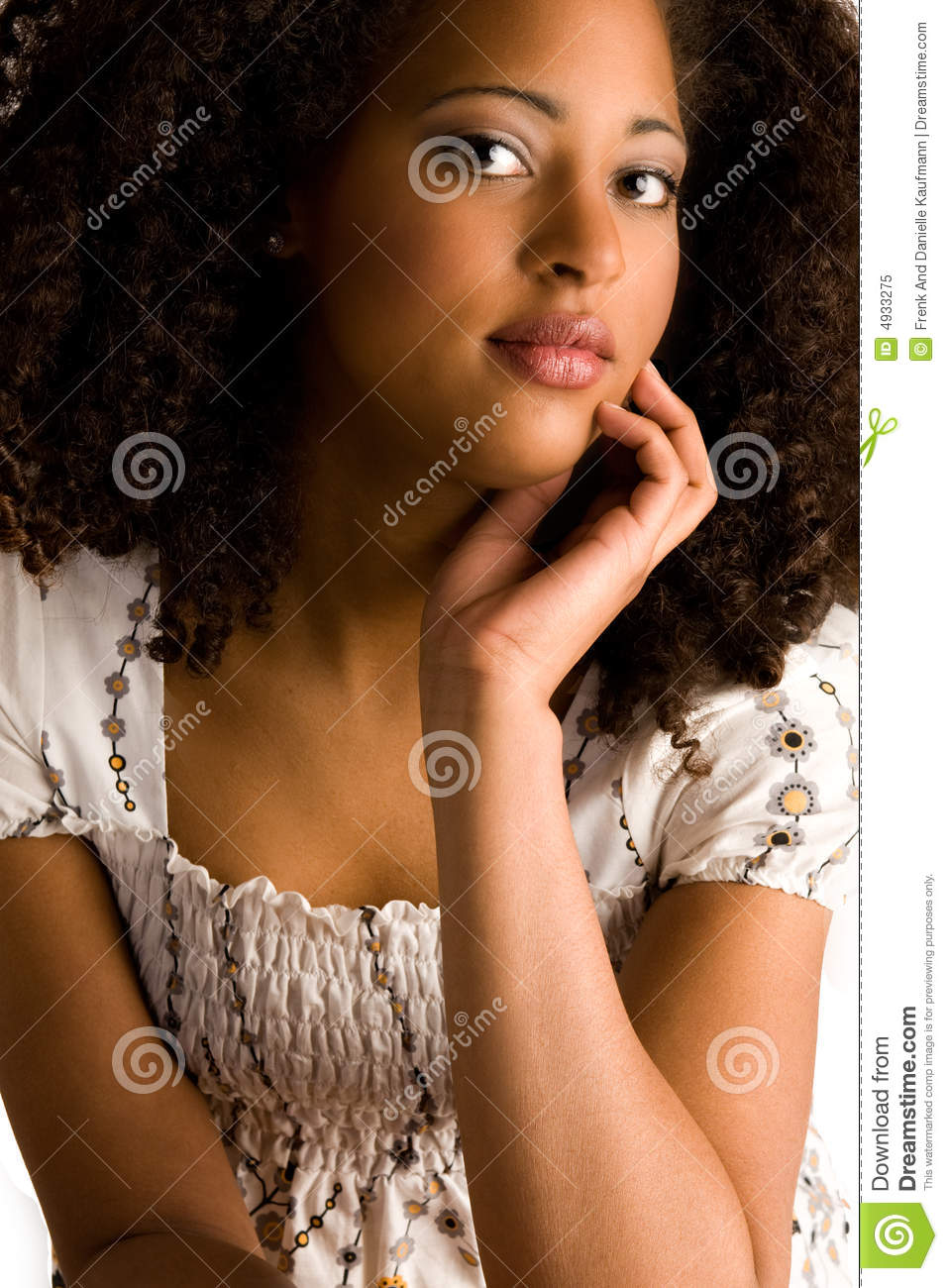 African woman with a hand on her chin