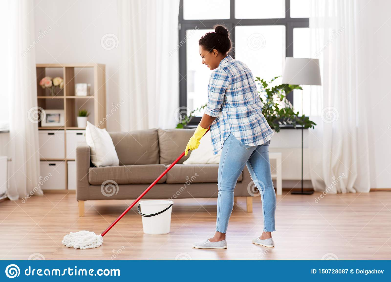 African Woman Or Housewife Cleaning Floor At Home Stock Image ...