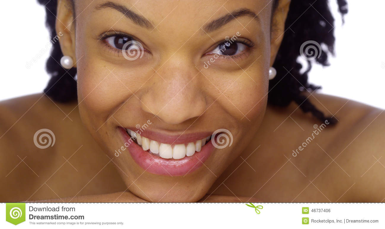African woman showing off her pearly whites