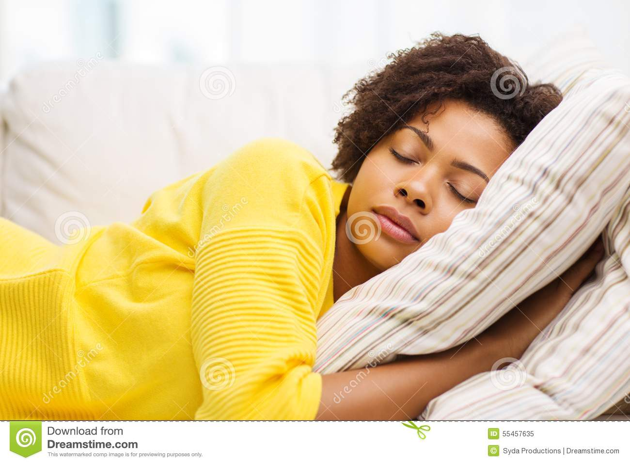 young woman on a sofa stock photo cartoondealer com cat on sale for cheap cat on sofa hits cat below